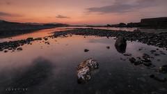 CENTERFOLD (jopetsy) Tags: sual pangasinan sunrise sunset seascape landscape fujifilm fuji philippines rain rock stones pebbles
