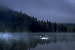 Boat in Mist (erika eve) Tags: sky lake mountains water night afterdark trilliumlake mthoodnationalforest