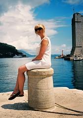 Sarah on bollard by Leica (Song-to-the-Siren) Tags: leica sarah clouds 35mm harbour croatia bluesky 35mmfilm analogue dubrovnik bollard adriatic leicaminilux kodakektar100