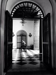 Enter (JCent8) Tags: old city vacation blackandwhite white holiday black classic architecture hotel doors oldsanjuan puertorico sanjuan pr enter convent