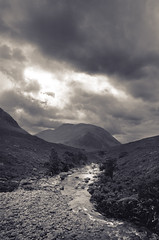 Glen Etive (JB Morlot) Tags: uk sky mountain storm film monochrome sepia clouds mediumformat river landscape scotland highlands stream solitude loneliness fuji space faith fineart dramatic pebbles destiny serenity glencoe duotone 6x9 dreamy wilderness moor eternity largeformat threat mystic timeless glenetive fujigsw690iii