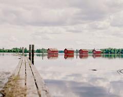 (Benjamin Skanke) Tags: bridge house reflection 120 film water norway clouds analog vintage river dark grey pier boat norge pentax takumar kodak gray slide plus medium format 24 100 6x7 epp expired akershus ektachrome smc e6 canoscan fetsund 67 sawmill lumber 120mm 105mm lenser