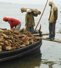 Firewood for funeral pyres (bokage) Tags: india boat funeral varanasi hindu hinduism firewood pyre ganga ganges benares ghat uttarpradesh bokage