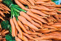 Beta Carotene (giantmike) Tags: food orange green vegetables farmersmarket bokeh madison carrots wi canonef100mmf28lmacroisusm