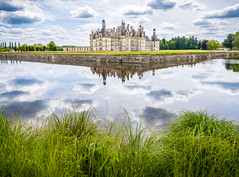 Château de Chambord (miemo) Tags: park travel summer sky lake france reflection castle water grass clouds garden europe exterior olympus loirevalley château omd loiretcher châteaudechambord em5 panasonic1235mmf28