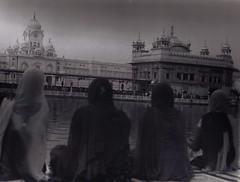 Prayers (bhavana0012) Tags: woman india white black film 35mm dark temple golden room sikh amritsar promaster
