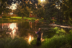 Fisher Boy (MilaMai) Tags: trees light boy red portrait house reflection beach nature water grass buildings suomi finland river fishing whitewater alone child young redhouse pole human fisher oneperson waterscape fishingrod noormarkku