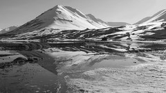 Vanity: even our planet succumbs to it ;) (lunaryuna) Tags: iceland northiceland northfjords mountains reflection fjord shoreline seeingdouble winter spring seasonalchange light lightmood blackwhite mbw monochrome