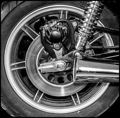 Wheel. (CWhatPhotos) Tags: wheel shocker hocks shock absorber exhaust brake disc rear end photographs photograph pics pictures pic picture image images foto fotos photography artistic cwhatphotos that have which with contain olympus em5 esystem four thirds digital camera lens olympusem5mkii focus wide view 43 fit mft micro yamaha 1979 us custom 650 bike motorcycle yam yammy xs classic motorbike black