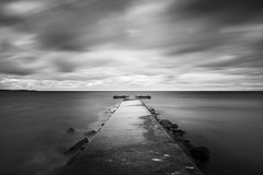 Stein Dramatisch II (Luziferian) Tags: jetty longexposure blackandwhite schwarzweis noiretblanc blancoynegro sea meer balticsea water dark drama atmosphere mood weather clouds movement landscape seascape