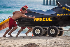 Oceanside Lifeguards (EthnoScape) Tags: oceanside california cityofoceanside firedepartment firedept lifeguard lifeguards oceansidelifeguards oceansidepier lifestyle training drown drowning surf surfer surfers surfboard lifesaver lifesavers rescue rescuer swim swimming swimmer swimmers athlete athletic health fitness youth boardshorts bikini wetsuit neoprene danger riptide ripcurrent red yellow baywatch fins swimfins tower lifeguardtower beach short ocean water safety tourist touristseason jetski summer sun sunset sunlight silhouette stock ethnoscape ethnoscapeimagery