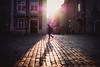 all lit up (ewitsoe) Tags: light sliver person woman walking shadow casting bright morning dawn sunrsie cobblestones buildings city poznan poland erikwitsoe ewitsoe nikon d80 35mm street cityscape winter