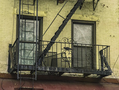"""Tenement Building Perspective (nrhodesphotos(the_eye_of_the_moment)) Tags: dsc0304972 ""theeyeofthemoment21gmailcom"" ""wwwflickrcomphotostheeyeofthemoment"" spring2017 season nyc manhattan outdoors building architecture windows shadows reflections fireescape texture tenementbuilding metal ladder"