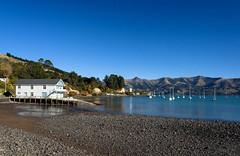 The Boathouse (Jocey K) Tags: newzealand southisland canterbury akaora bankspeninsula sky akaoraharbour hills sea sand boats reflections scene lighthouse trees buidings