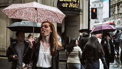 Bubble Gum 40/156 (markfly1) Tags: london picadilly circus colour umbrellas wet weather raining street candid photography pink red headed hair chewing bubble gum people nikon d750 50mm