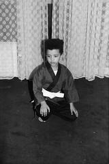 Disciple of the 36th Chamber. (35mm) (samuel.musungayi) Tags: 35mm film negative négatif negativo 24x36 135 pellicule pelicula argentique analog family eighties vintage people archive archives brussels enfant personnes portrait afro shaolin 90s monochrome cameo high top home jeet kune do martial art