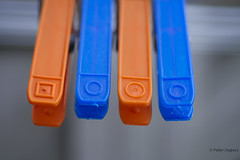Laundry is the only thing that should be separated by color (Peter Jaspers (sorry less time to comment)) Tags: frompeterj© 2017 olympus zuiko omd em10 1240mm28 macromondays orangeandblue orange bleu oranje blauw macro dof clothespin wasknijper home