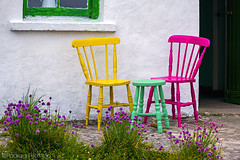 IMG_5432 (padraig thornton) Tags: chairs stool outdoor canon yellow green white pink garden grass wildflowers house colorful colours camera 7d 70200mm padraigjosephthorntongmailcom greatphotographers wow