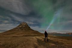 Ignite the night ([ Jaso ]) Tags: kirkjufell iceland aurora northernlights borealis nikon d750 light shine torch person mountain night nightscape astro sky green grass landscape horizon glow standing silhouette