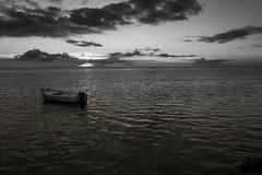 la barca solitaria (paolotrapella) Tags: barca mare acqua cielo nuvole bianco nero boat sky clouds water bw