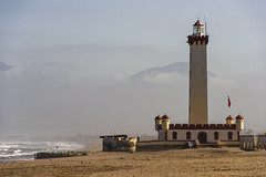 La Serena Lighthouse (Tom Kilroy) Tags: chile laserena coquimbo nationalgeographiclinblad nationalgeographic lighthouse sea coastline beacon famousplace nature landscape sky beach outdoors architecture water scenics travel harbor watersedge cloudsky