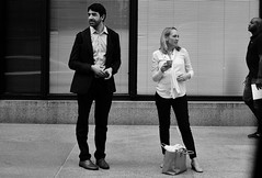 Opposite Don't Always Attract (burnt dirt) Tags: houston texas downtown city town mainstreet street sidewalk corner crosswalk streetphotography fujifilm xt1 bw blackandwhite girl woman people person phone cellphone purse bag standing walking man couple pair beard blonde
