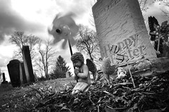 April Sorrows (drei88) Tags: easter forlorn bleak spinner grim stark dreary stormy cloudy energy wind pinwheel angel charged moment searching april cherub empty eternal