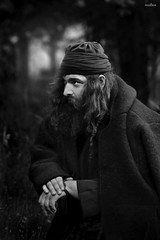 the priest (dim.pagiantzas   photography) Tags: priest revolution historical history movies movie cinema cinematic cine man environment entertainment male people atmospheric light bokeh portrait look nature forest outdoor trees grayscale monochrome blackandwhite faces canon