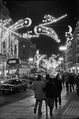 London, Regent Street Lights. (christopherhogg1) Tags: chrishoggsphotos regentstreet london lights decorations street traffic city car bus motorvehicle shop building architecture