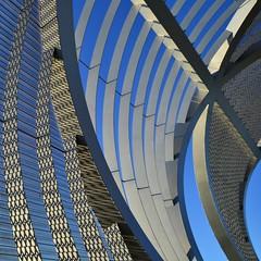 The Perrault  * (TheManWhoPlantedTrees) Tags: madrid bridge blue sky españa lines metal architecture grid grey spain shadows footbridge asterisk 100views dominiqueperrault bsquare arganzuela quadratum nikond3100 tmwpt