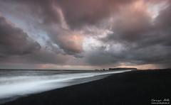 Volcanic Beach - Vík, Iceland (orvaratli) Tags: ocean sea seascape black beach clouds landscape iceland sand arch wave atlantic volcanic vík dyrholey reynsfjara