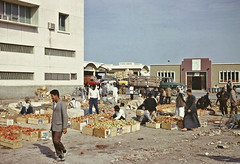 Tomato market in Doha suq, Qatar, 1967 (annkelliott) Tags: people men vegetables market tomatoes middleeast oldphoto selling doha qatar buying suq scanofprint fromcolourslide 17february1967 tomatomarket
