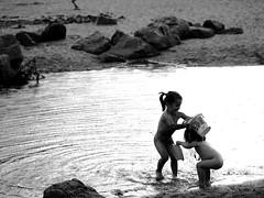 Wildlife V (making mischief) (Srta. Buendia) Tags: girls sunset sea bw baby sun blancoynegro sol beach girl beauty atardecer mar lluvia child little bonito naturallight paisaje nia bebe bella hermoso nias luznatural ederra