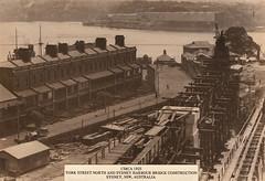 Sydney Harbour Bridge construction from York Street North [ie. Cumberland Street], Dawes Point, Sydney, Australia (c.1925)
