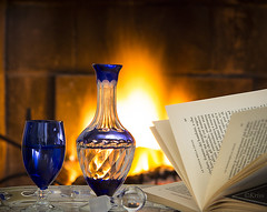 Relax... take it easy! (Cristina Favaro) Tags: glass canon fire book bottle fireplace flame flickrsfinestimages1 flickrsfinestimages2 flickrsfinestimages3