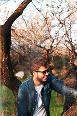 (Marta Nrgaard) Tags: trees light boy portrait man male guy film nature sunglasses fashion canon vintage model grain retro jacket indie denim hairstyle rayban lightroom vision:outdoor=0734