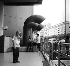 Smoke break (orzalana69) Tags: sim lim square smoke break smoking singaporestreetphotography streetphotography ikoflex lucky pan 100 ilfotec bw filmphotography analog
