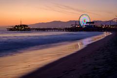 Winding down (BrianEden) Tags: ferriswheel xpro1 ocean sunset pier beach losangeles sky sand fuji santamonica fujifilm la california unitedstates us