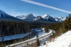 An Ominous Stripe Across the Sky (Kristin Repsher) Tags: alberta banff banffnationalpark canada canadianrockies clouds d750 lakelouise morantscurve mountains nikon rockies rockymountains snow winter