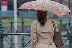 IMG_9521 Raincoat and umbrella (Rodolfo Frino) Tags: rain raincoat weather lluvia chica girl raining sydney australia circularquay woman umbrella beige brown red yellow green blue