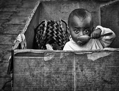 Breakfast in a Box (Rod Waddington) Tags: africa afrique madagascar malagasy child breakfast box streetphotography street streetphoto candid blackandwhite cardboard spoon