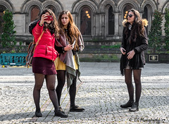 Roles Reversed (Fermat48) Tags: manchester albertsquare young ladies smartphone mobile phone selfie selfiestick townhall bee canon eos 7dmarkii cobbles