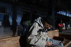 Newspaper (dtanist) Tags: nyc newyork newyorkcity new york city sony a7 konica hexanon 40mm brooklyn coney island stillwell avenue station mta terminal subway newspaper reading read paper commuter