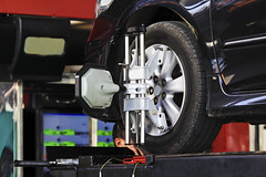 Car wheel fixed with computerized wheel alignment machine clamp (KLS POWER GROUP) Tags: wheel car tire mechanics clamped clamp test jack auto closeup bear clutch engineering lifting align fix mechanical service adjusting engineer balance rotating vehicle technology rim fixing equipment automobile transport fixed industrial adjustment close repairshop maintenance alignment platform machine transportation bearings board aligner repair industry aligning shop setup servicing metal