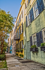 Strolling Down Rainbow Row (Spencer Bawden Photography) Tags: rainbow row charleston south carolina house buildings home color colorful houses sidewalk europe paris georgian windows doors balcony shutters flowerbox old spencer bawden spazoto