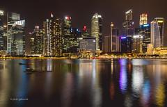 Singapore by Night (pietkagab) Tags: singapore asia asian city night longexposure buildings skyline skyscraper skyscrapers lights reflections pietkagab photography pentax piotrgaborek pentaxk5ii travel trip tourism sightseeing outdoors panorama panoramic southeast architecture