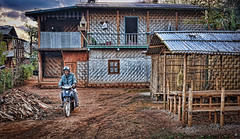 Our porter and cook Zayar Hein leaving the house we stayed in last night (Neville Wootton Photography) Tags: burma holidays homestays kalaw lightroom myanmar onestoptraveltours patu topazlabs zayarhein