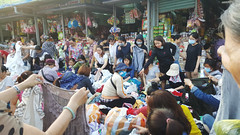 """That one..."" (Roving I) Tags: buying looking clothes clothing con markets pointing danang facemasks shopping sunhats vietnam"