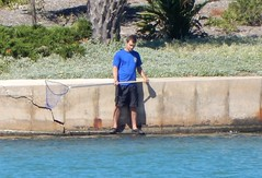 I guess he's trying to catch fish..... (mikecogh) Tags: westlakes hopeful net unusual fishing