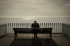 Contemplating (Welsh Photographer) Tags: lone man figure seat sitting thinking sea view da pentax k3ii 1650mm
